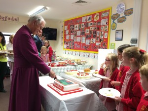 Archbishop cuts cake - All Saints, Barry
