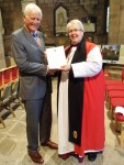 Christopher Griffiths receives his award at the Cathedral