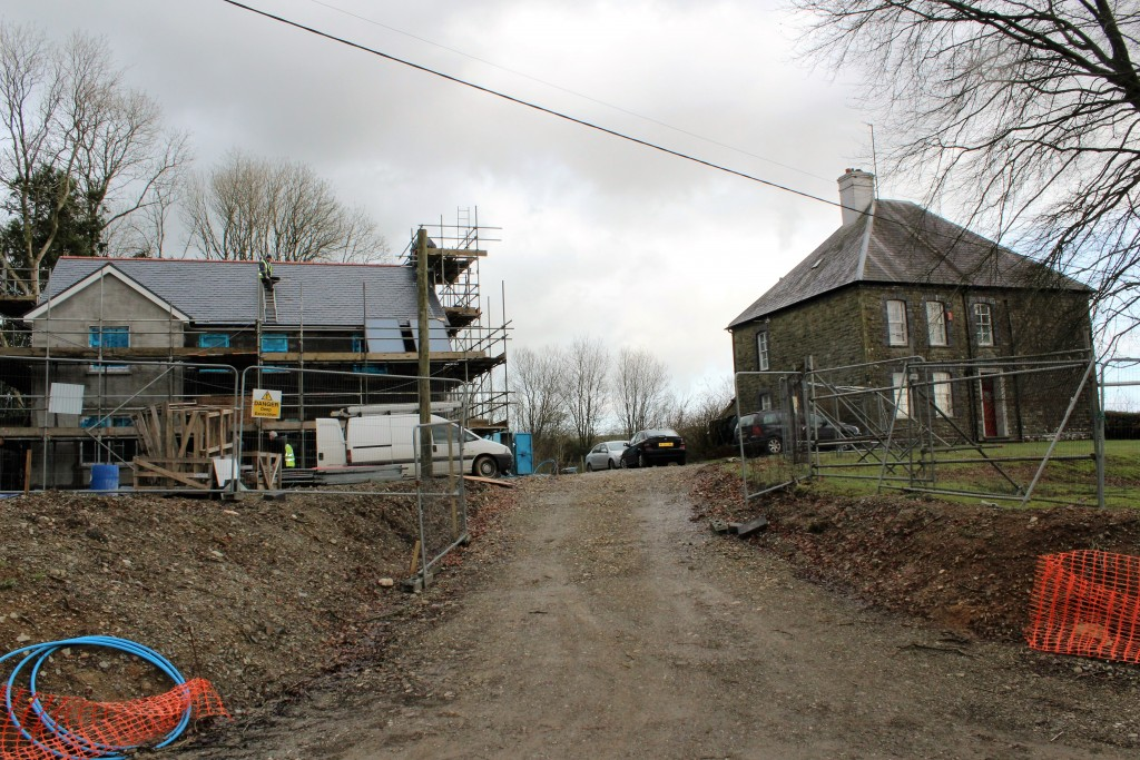 A new vicarage is taking shape in Llanpumsaint, next to the old one