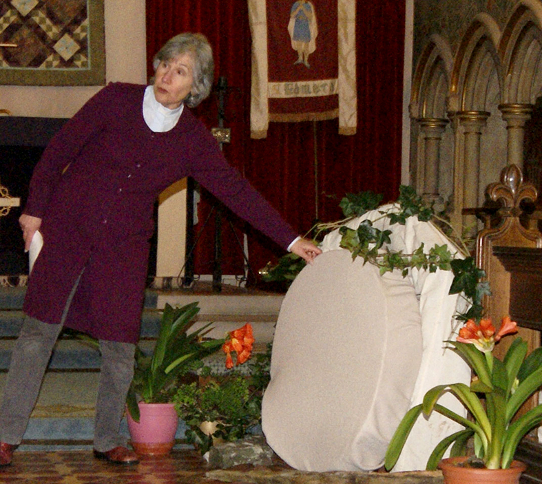 Rev Canon Melia Cope rolling away the stone as she explained to the children the meaning of breaking open an Easter egg