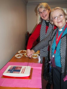 Enid Morgan and Margaret Harvey cut the cake