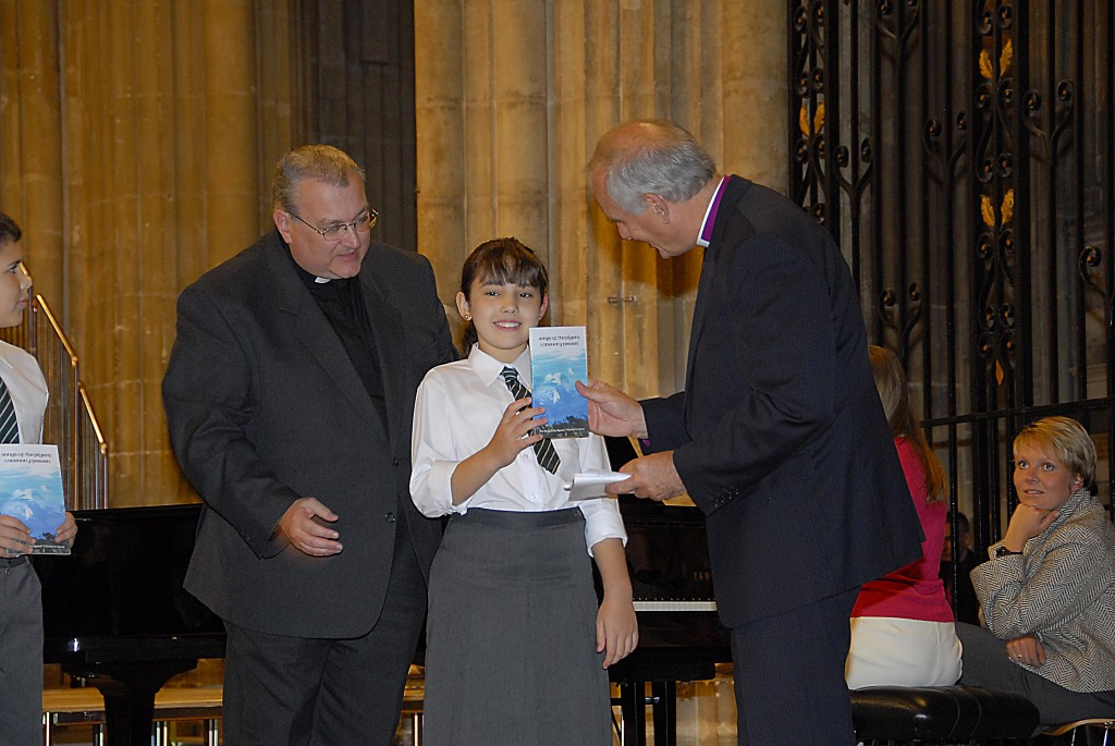Chloe at the Canterbury Cathedral concert in 2008 with Fr Paul (left) and the Archbishop of Wales (right)