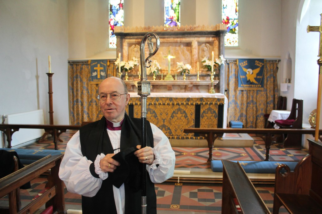 Bishop Wyn visiting the church of his childhood, St John's, Penrhyncoch, where his father was vicar